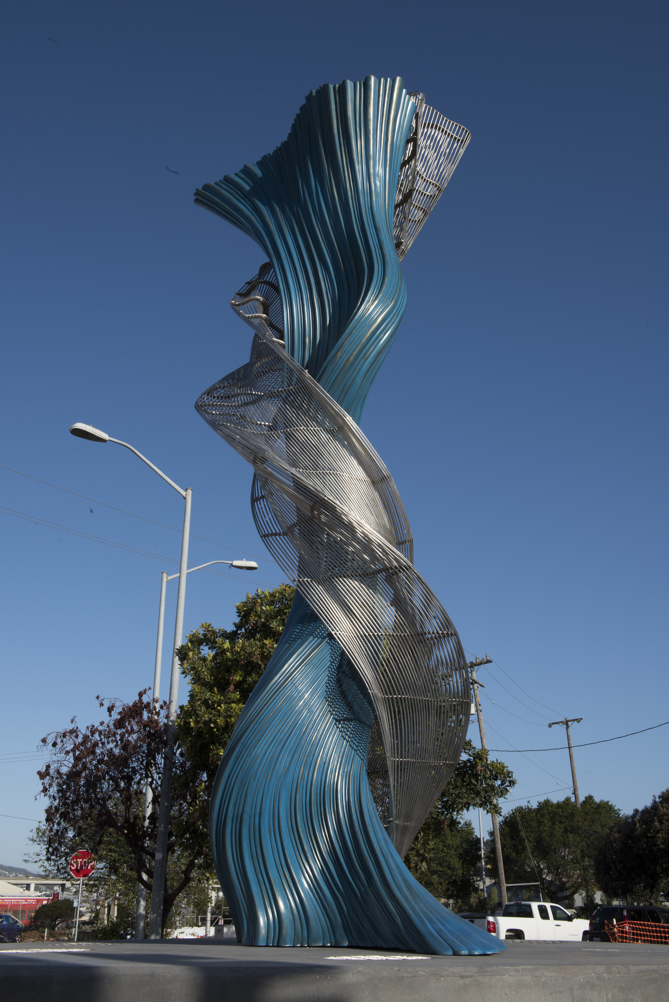 Blue and silver spiraling sculpture at Islais Creek